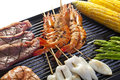Shrimp on the grill squid beef corn and asparagus Royalty Free Stock Photography