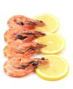 Shrimp with lemon on a white background Royalty Free Stock Photos