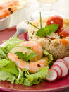 Shrimp with lettuce and couscous Stock Photo