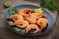 Shrimp with lime on plate Royalty Free Stock Photo