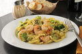 Shrimp linguine with broccoli and sliced bread Royalty Free Stock Photo