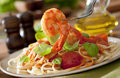 Shrimp pasta closeup of with tomato sauce and basil Royalty Free Stock Photos
