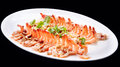 Shrimp prawn appetizer cooked seasoned seafood dish  isolated on black background , chinese cuisine Royalty Free Stock Photo