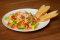 Shrimp salad with vegetables and sauce Stock Images