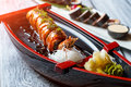 Shrimp on sushi boat.