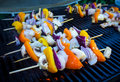 Shrimp and vegetable skewers on barbecue Stock Image