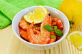 Shrimp in a white bowl with lemon slices Royalty Free Stock Photo