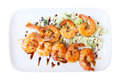 Shrimps skewers two of on a white rectangular platter isolated on white background top view Stock Images