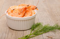 Shrimps in a white bowl on wooden table Stock Images
