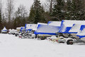 Shrink wrapped boats in snow Royalty Free Stock Photo