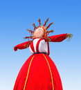 Shrovetide in russia big doll for the burning ove on blue sky background Stock Photos