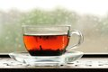 Shu puerh tea brewed in glass cup on window sill horizontal Stock Image