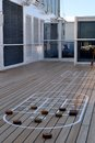 Shuffle board court on ship a typical deck of a cruise with broom like paddles and round pucks Royalty Free Stock Photography