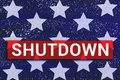 Shutdown Text With stars of Us Flag on blue background
