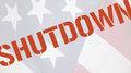 Shutdown word on old flag american with the in red type Stock Photo