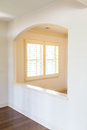 Shutters through arch white plantation in a new home Royalty Free Stock Photo