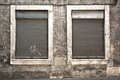 Shutters detail of closed windows with on an old abandoned building Royalty Free Stock Photo