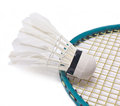 Shuttlecock with badminton racket on white background Stock Photography