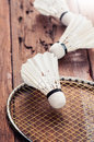 Shuttlecock badminton racquet and on wood Royalty Free Stock Images