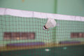 Shuttlecock seized by the net in badminton courts Royalty Free Stock Photo