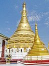 Shwe muay wan temple paya is a myawaddy x s most important a traditional bell shaped stupa gilded with many kilos of gold and Stock Image