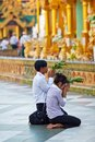 Shwedagon pagoda in yangon myanmar january pilgrims with offering flowers praying at golden paya on january Stock Photography