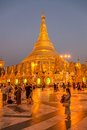Shwedagon pagoda yangon myanmar march sunset at the with prayers and tourists sightseeing on march in yangon myanmar Stock Photography