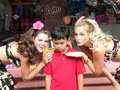 Shy boy and pretty women fun summer theme park in universal studio california the who had fun whole day suddenly get to take photo Stock Photos