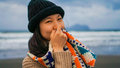 Shy girl covered her face at the beach in yilan county taiwan Royalty Free Stock Photo