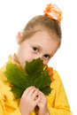 Shy girl with green maple leaf in his hand Royalty Free Stock Photo