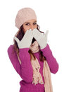 Shy girl with wool hat and scarf isolated on a white background Royalty Free Stock Photos