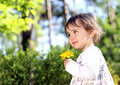 Shy girl with yellow flower Royalty Free Stock Photos