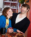 Shy man and aggressive woman Stock Photos