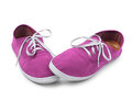Shy pink sneakers isolated on white shyness concept Royalty Free Stock Photography