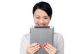 Shy pretty corporate lady holding tablet device smiling asian businesswoman pc Stock Images