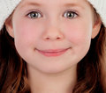 Shy pretty little girl with wool cap Royalty Free Stock Photo