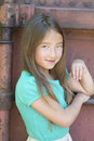 Shy, Smiling Girl with Long Brown Hair Royalty Free Stock Photo