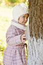 Shy toddler girl near the tree Royalty Free Stock Photos