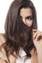 Shy woman hiding behind her hair Royalty Free Stock Images