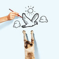 Siamese cat image of catching drawn bird Stock Photos