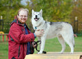 Siberian Husky with a man Stock Image