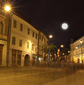 Sibiu also called hermannstadt its old city centre night nicolae balcescu pedestrian street crowds people walking night blur Stock Photos