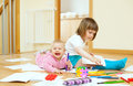 Sibling plays with pencils cheerful in home Royalty Free Stock Photos
