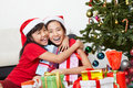 Sibling showing love in Christmas season Royalty Free Stock Photography
