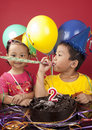 Siblings celebrating birthday Royalty Free Stock Images