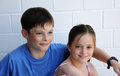 Siblings in cohesion happy hugging each other Stock Photography