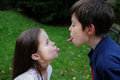 Siblings in conflict have a and poking their tongue out to each other Stock Photos