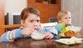 Siblings eating dairy breakfast