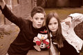 Siblings happy hugging each other and posing with plush toy snowman Royalty Free Stock Image