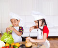 Siblings making sandwich Royalty Free Stock Photography